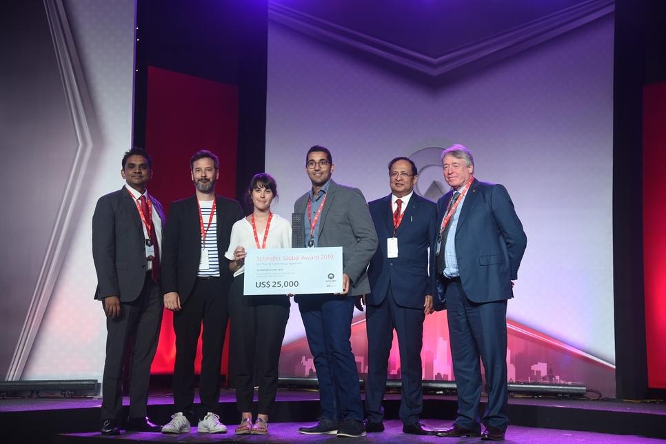 Ashok Ramachandran, Uday Kulkarni, and Robert Seakins with the winning team.