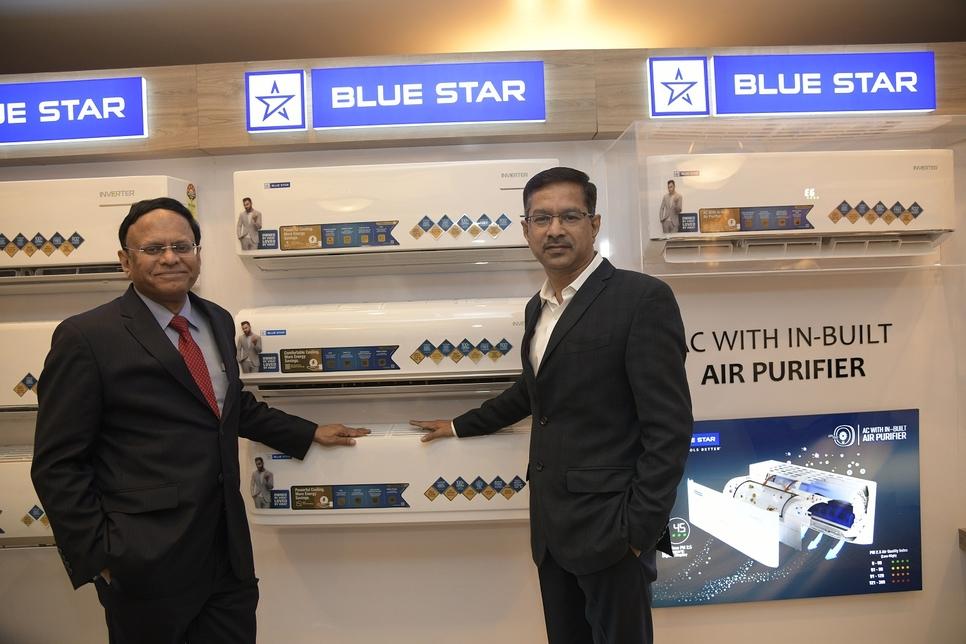 B Thiagarajan (left) and C Haridas, VP, sales & marketing, room air conditioners division, at the launch.